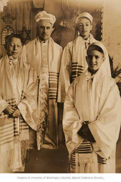 Rabbi Isidore Kahan (2nd from left) with bar mitsva boys Leon Uziel, Moe Azose, and Meyer Varon at Sephardic Bikur Cholim in Seattle, WA