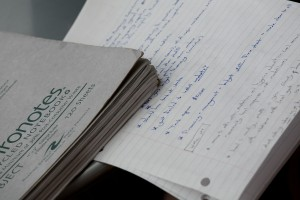 detail of notebook and handwritten note with pen and keyboard
