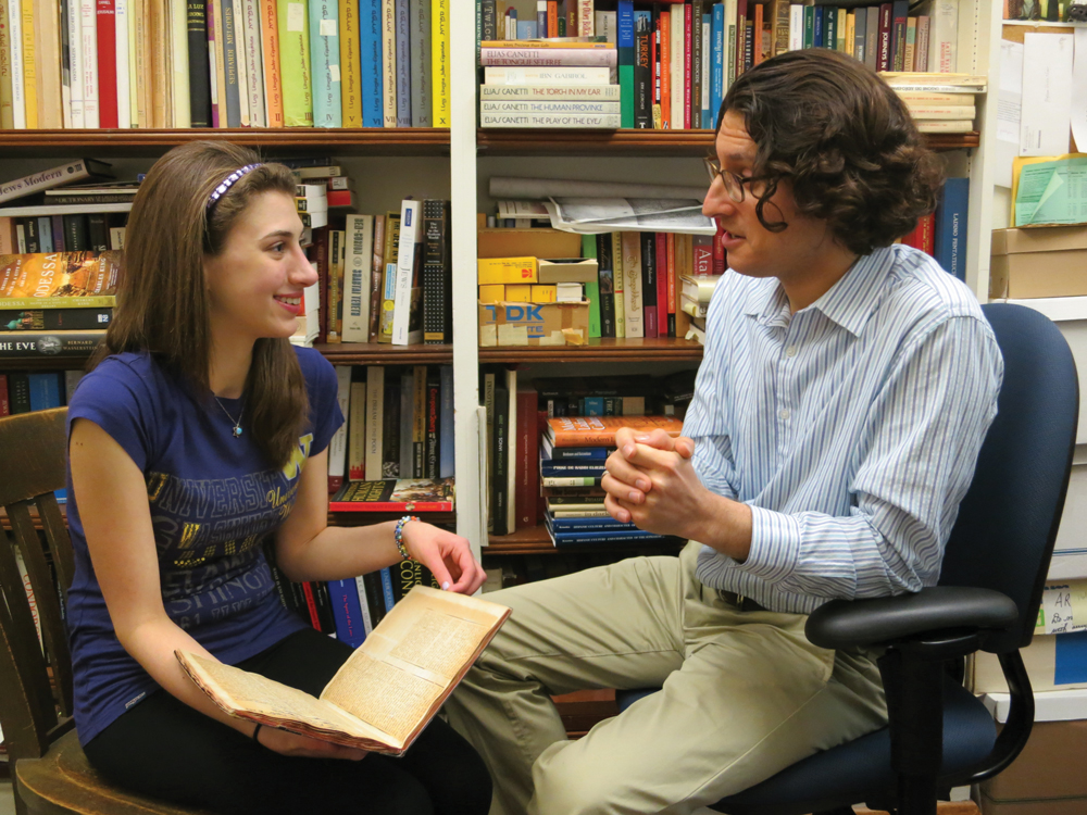 Ashley Bobman discusses her great-grandfather's notebook with Prof. Devin Naar, who is supervising her exploration of Ladino and Sephardic history.