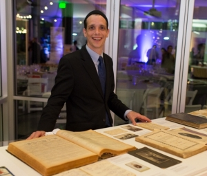 Ty Alhadeff with the exhibit of Seattle Sephardic Treasures at the Jewish Studies 40th Anniversary Gala. Photo by Meryl Schenker.