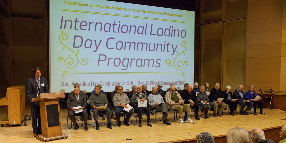 Prof. Devin Naar and Los Ladineros take the stage in Kane Hall at International Ladino Day 2014. Photo by Meryl Schenker Photography.