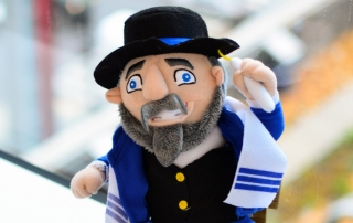 This year's Hanukkah toy sensation, the Mensch on a Bench, brings shtetl nostalgia into the Hanukkah story.
