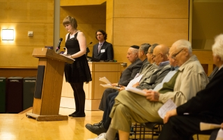 PhD student Molly FitzMorris takes the stage with Prof. Devin Naar and the Seattle Ladineros at Ladino Day 2014. Photo by Meryl Schenker Photography.