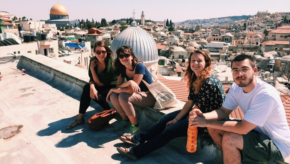 Jenna Mark, second from right, sits on top of the Austrian Hospice in the Old City of Jerusalem.