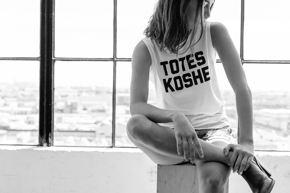 "The ""Unkosher Market"" line of sleeveless T's has Yiddishy, slangy slogans like ""Totes Koshe."" Photograph: Neph & Becky Trejo"