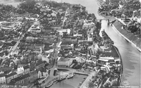 Aerial view of central Södertälje, ca. the 1960s. Södertälje lies southwest of Stockholm. The city's canal connects Lake Mälaren to the Baltic Sea.