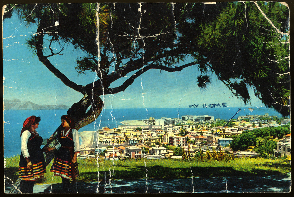 Postcard from Victor Capeluto to his sister Rachel Shemarya with an arrow pointing to their former home on the Island of Rhodes