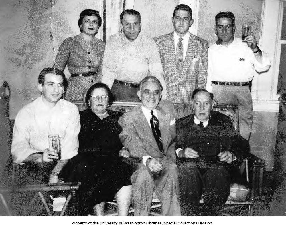Seattle's Sephardic pioneers Marco Calvo and Jacob Policar celebrating Thanksgiving with family and friends in Seattle, ca 1940-1945. (Courtesy of the WSJHS collection at the University of Washington Digital Collections)