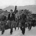 A young George Watt marches with his unit in Spain