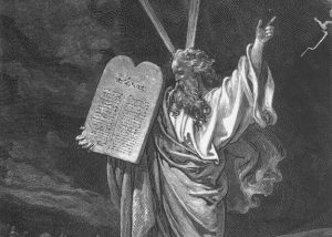 Engraving of Moses bringing the tablets of law to the people