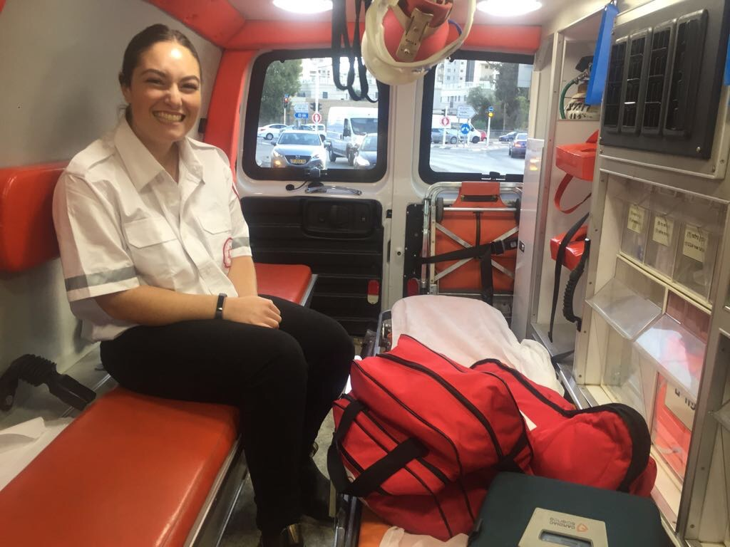 Image of Tess in the back of an ambulance.
