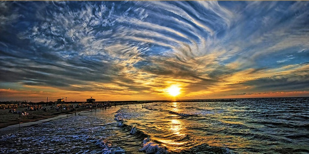 Photograph of a swirling sunset on a Tel Aviv beach