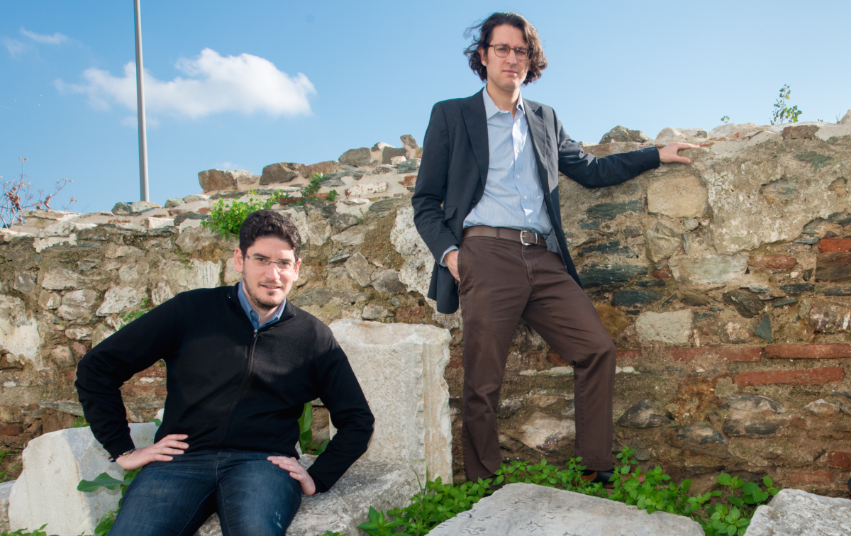 Devin Naar and Leon Saltiel beside scattered tombstones from the Jewish cemetery of Salonica, November 2014.