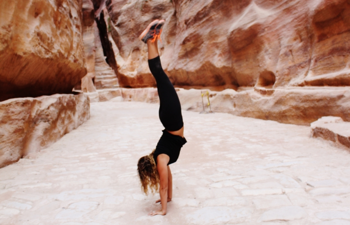 Jenna Mark learned that when visiting the Middle East, expectations can be turned upside down. Here, she does a handstand while visiting Petra, Jordan.