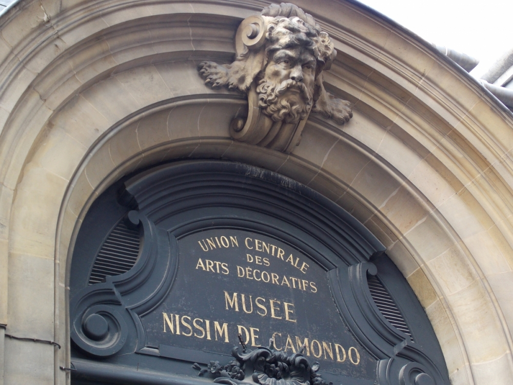 An archway with an architectural flourish reveals the name of the museum, named in memory of Moise De Camondo's father as well as his son.