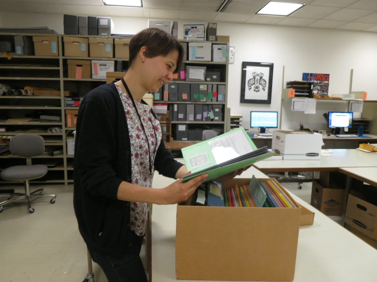 Graduate Fellow Emily Thompson looks at an oja (special Ladino blessing) from the Albert Adatto collection.