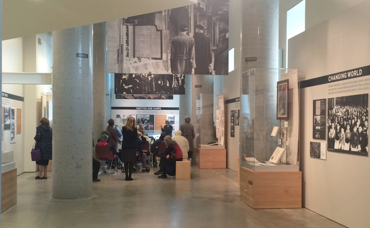 A tour group in the main exhibition space at the Holocaust Center for Humanity in downtown Seattle. Photo Credit Katja Schatte.