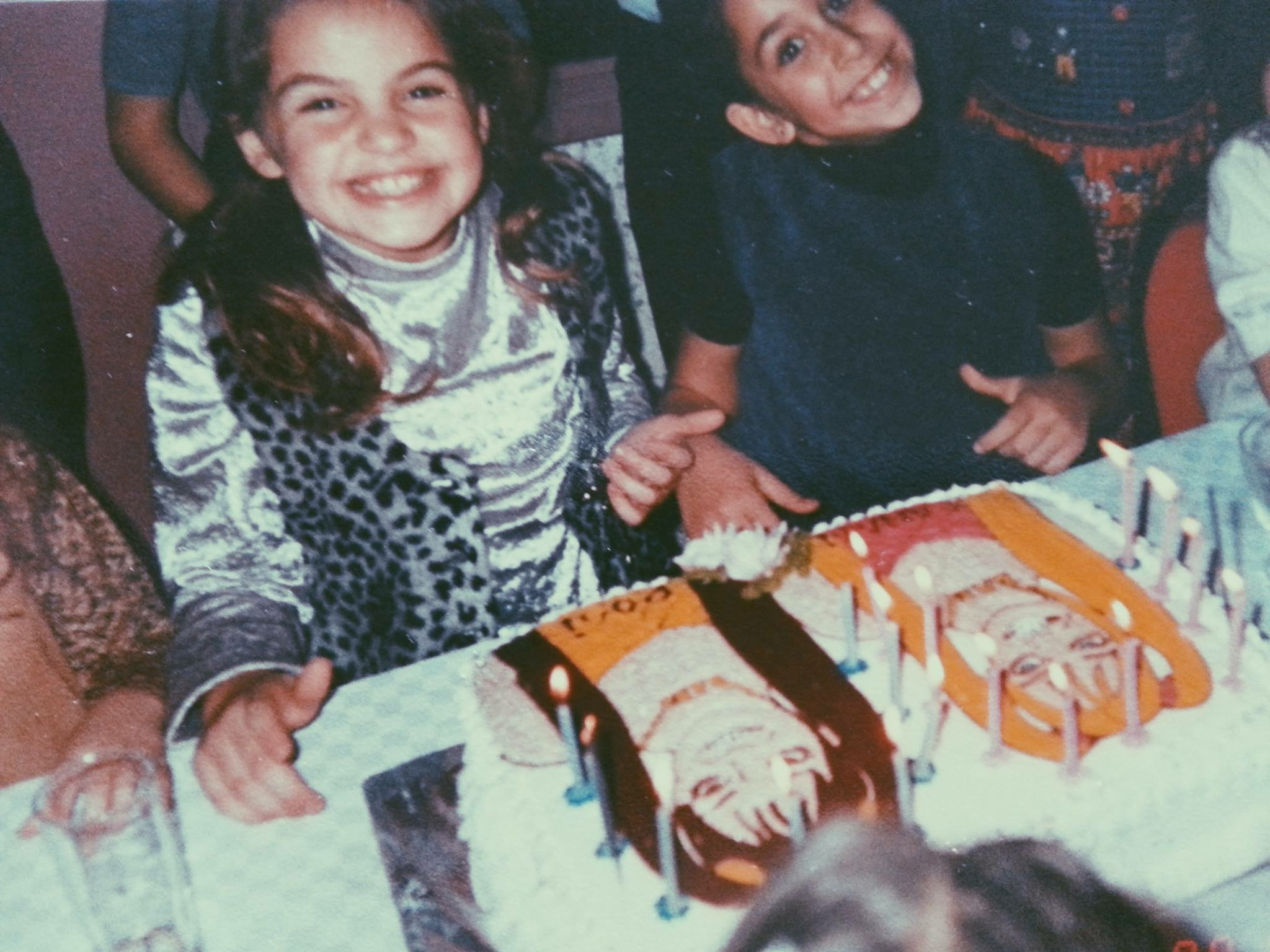Canan Bolel (left) with her childhood friend, Rozi, in Izmir, Turkey sitting in front of a birthday cake