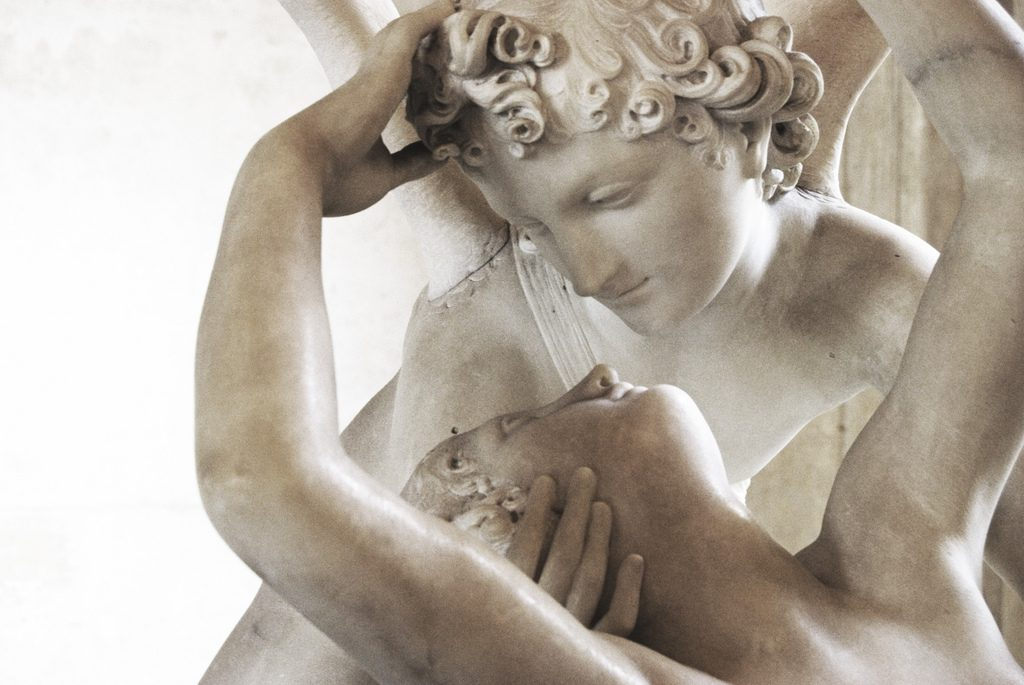 Cupid holds Psyche close.