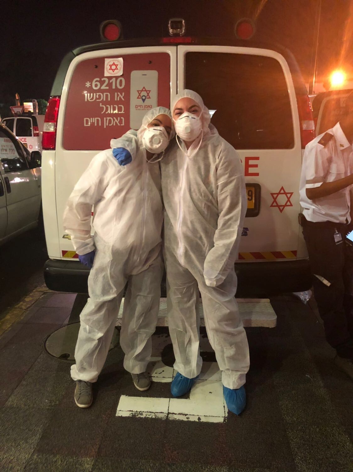 Image of Tess Seltzer Wearing biohazard protection suits after transporting a patient with an infectious disease.
