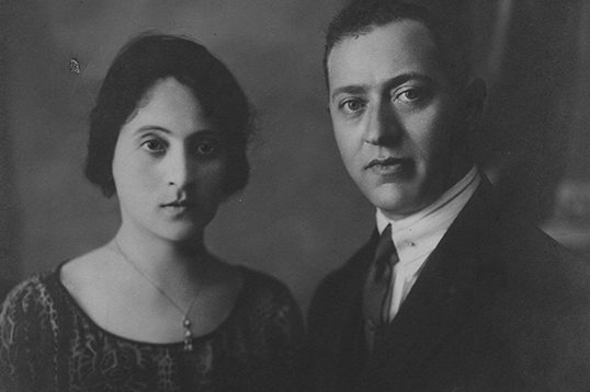 Historical photograph of a Greek Jewish married couple in dress and suit