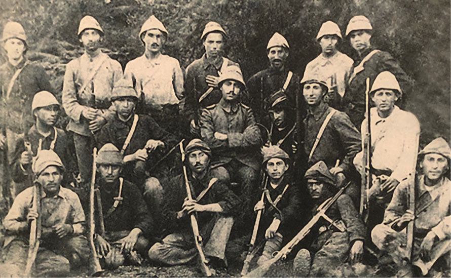Black and white photograph of a group of soldiers bearing rifles