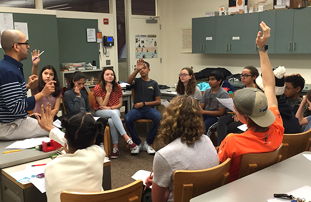 Students participate in a classroom discussion
