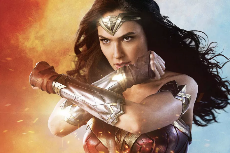 Gal Gadot as Wonder Woman uses her bracelets to deflect fire