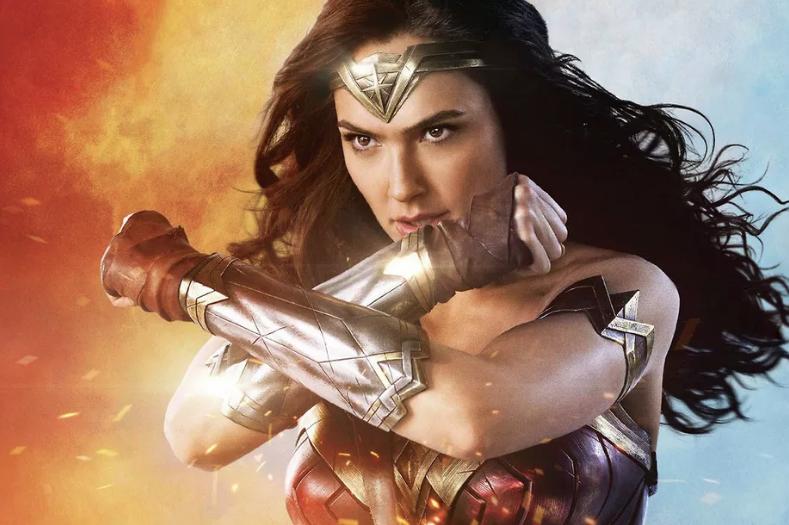 Gal Gadot as Wonder Woman uses her bracelets to deflect fire