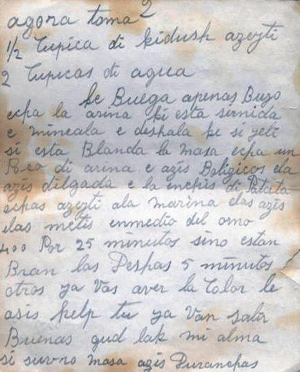 """A handwritten recipe written in cursive in pencil, calling for """"1/2 cupica di kidush azeyti"""" and """"2 cupicas di agua"""""""
