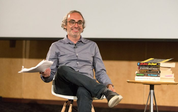 Author Gary Shteyngart smiles winningly at the audience after reading a manuscript copy of his memoir,