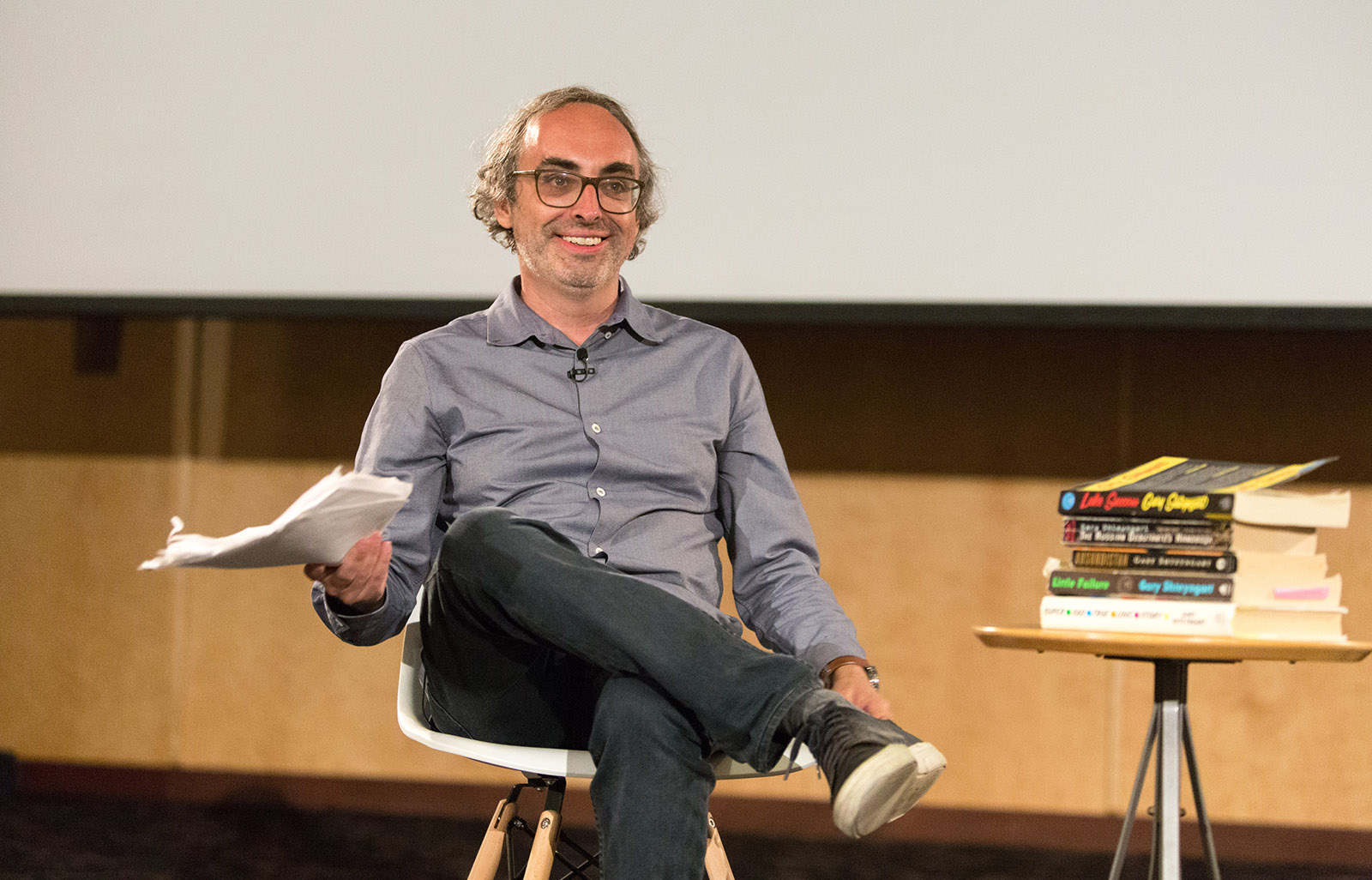 "Author Gary Shteyngart smiles winningly at the audience after reading a manuscript copy of his memoir, ""Little Failure"""