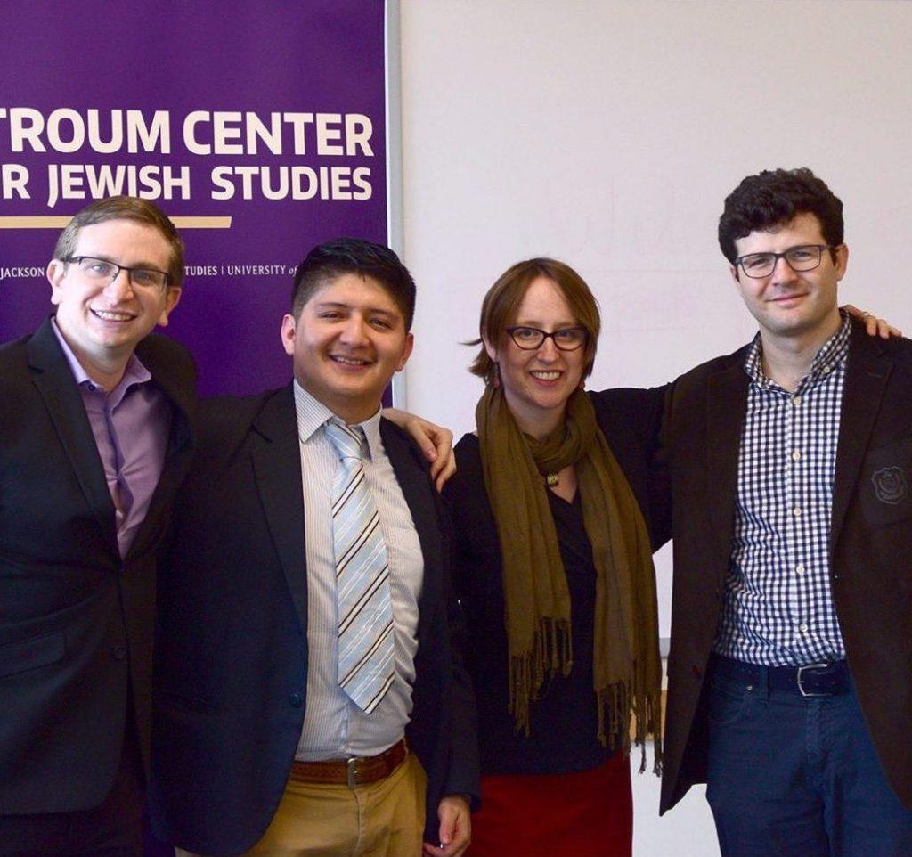 Three Graduate Fellows stand, smiling, with Professor Liora Halperin following research presentations