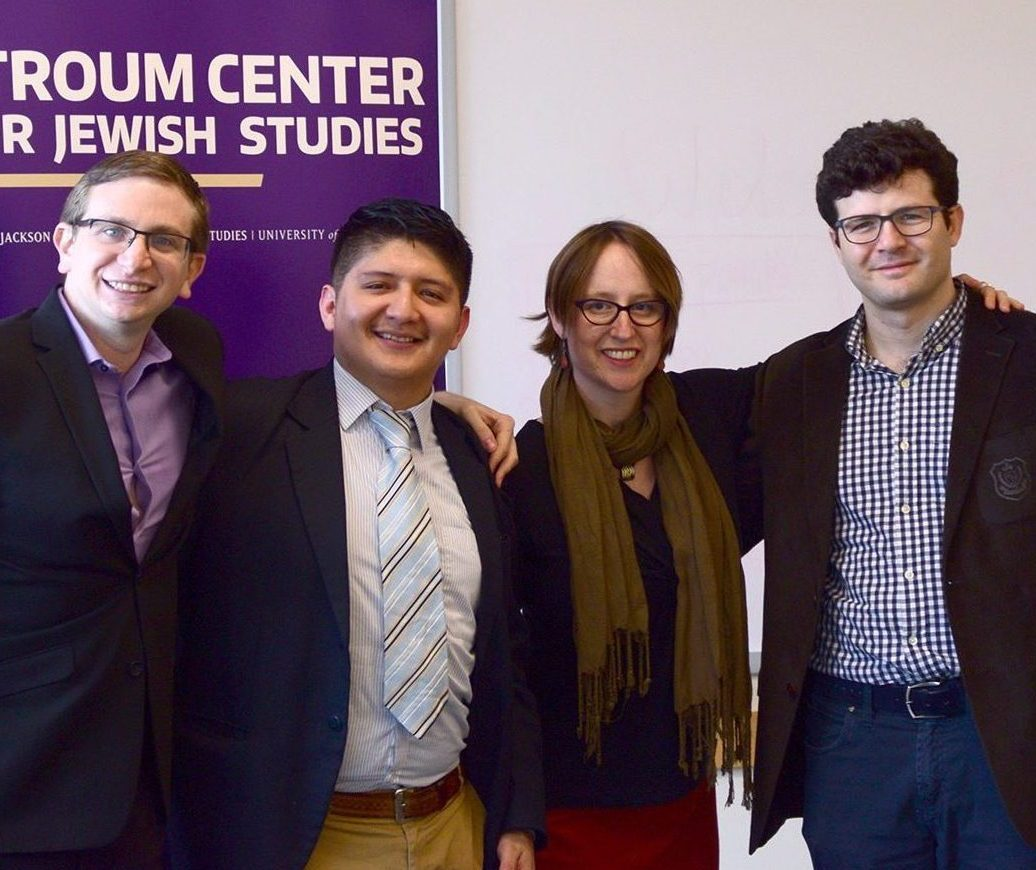 Three Graduate Fellows stand, smiling, with Professor Liora Halperin following research presentations