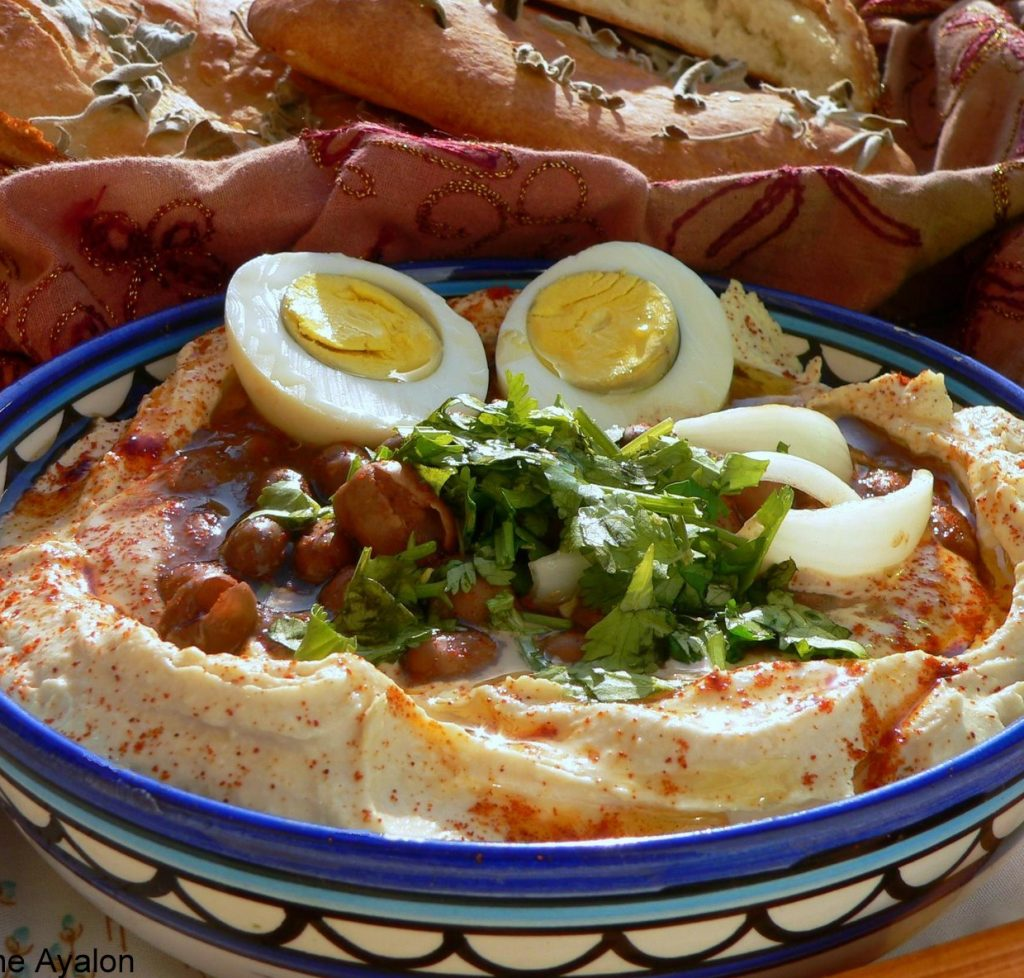 "Appetizing photo of ""komplet"" hummus, which includes egg, beans and parsley"