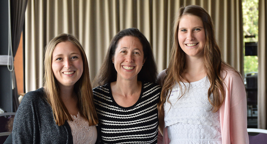 Photo of Student Engagement Director Lauren Kurland with students, smiling