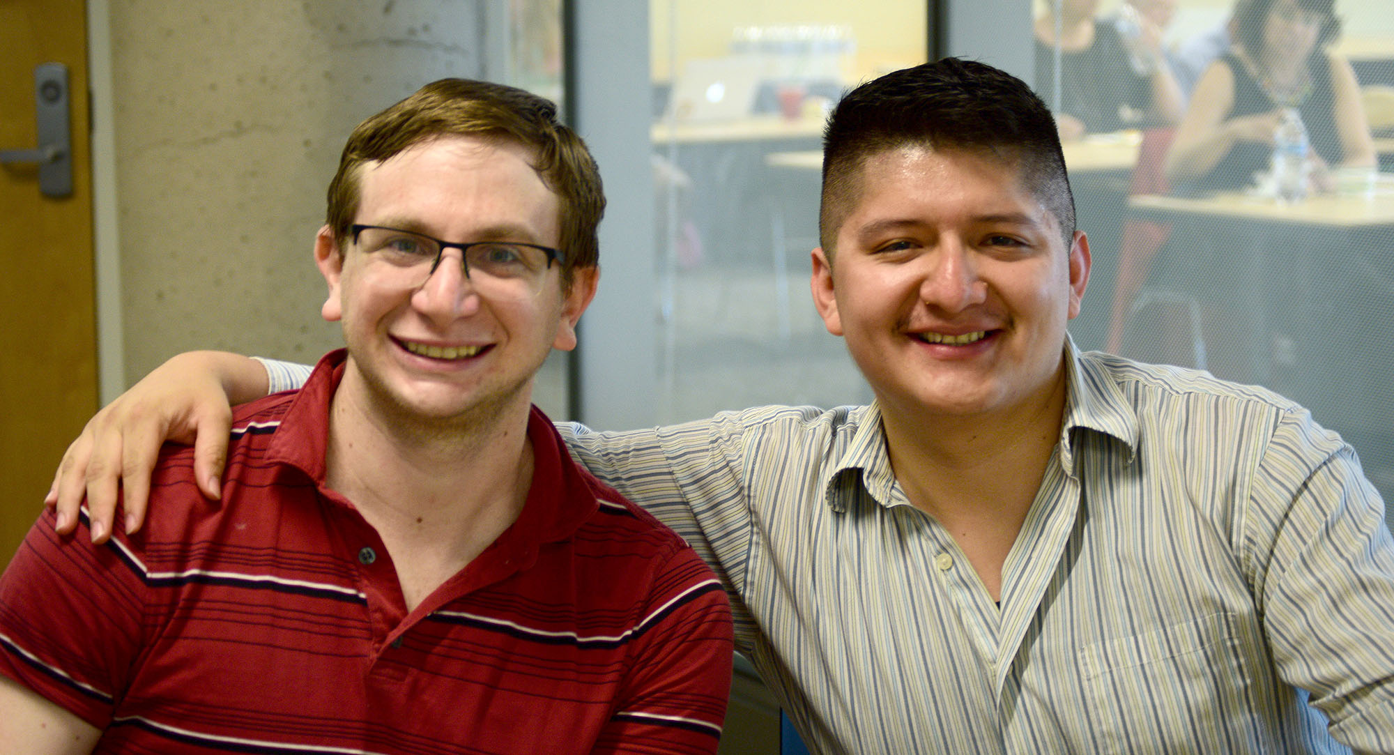 Two Graduate Fellows smile together, facing the camera