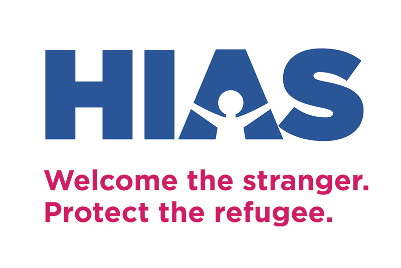 "Logo for HIAS showing a figure with outstretched arms in the A, with the phrases ""Welcome the stranger, protect the refugee"" below"