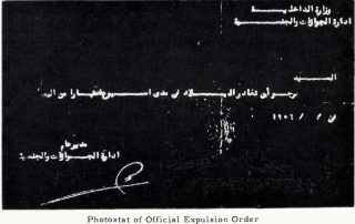 "A black-and-white negative photostat showing several lines in Arabic, with a date and signature below. A caption reads, ""Photostat of official expulsion order."""