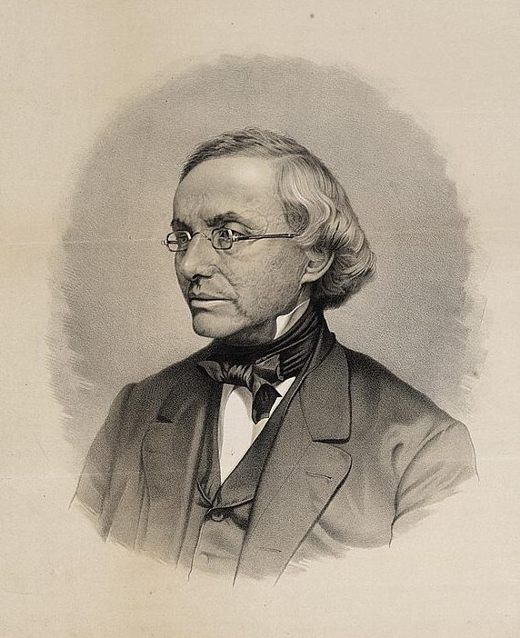 A historic black-and-white photograph portrait showing Isaac Leeser in suit, tie and glasses, seen in 3/4 profile