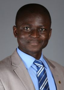 Francis Abugbilla wearing suit jacket and tie