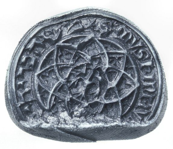 """A sample wax stamp shows the historic seal, with a rosette in the center ringed by the name """"Muskinus"""" in Roman and Hebrew letters"""