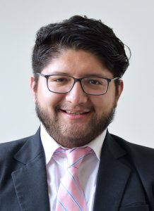 Portrait of Pablo Jairo Tutillo Maldonado smiling, wearing a suit and tie