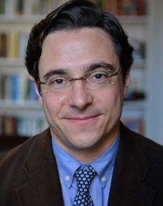 Dov Waxman, wearing a suit and glasses, from the shoulders up