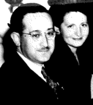 Black-and-white photograph shows Mitchell Wise with glasses, tie, dress shirt and coat, next to Sophie, smiling, wearing a suit jacket
