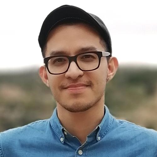Author Victor Alejandro Castillo headshot, wearing black glasses, a blue denim button down shirt, a black baseball cap.