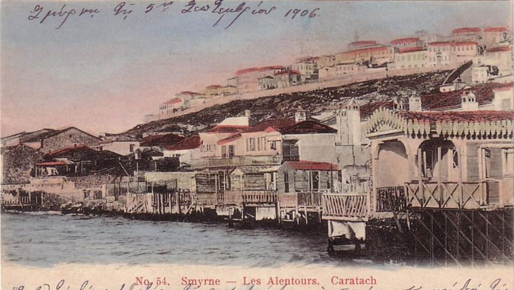 "Colorized postcard showing raised houses on hillside, built directly above the water. The postcard is dated 1906 in handwriting and reads ""Smyrna — Les Altenours, Caratach"""