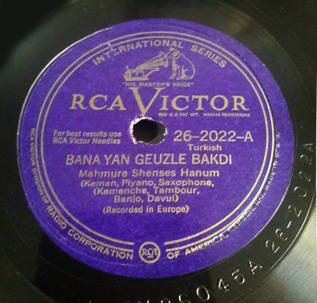 Purple Turkish record label close up against a black record.
