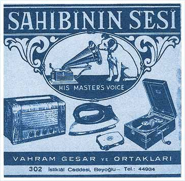 Turkish ad for records and phonographs. The paper is light blue and the text and illustrations are navy blue. Illustrations include an old TV at left, an iron in middle, and a record player at right. At the top is a decorated phonograph.