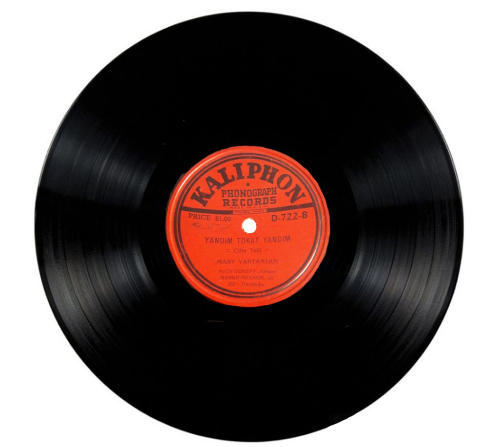 Black vinyl record with a red Turkish label in the middle.